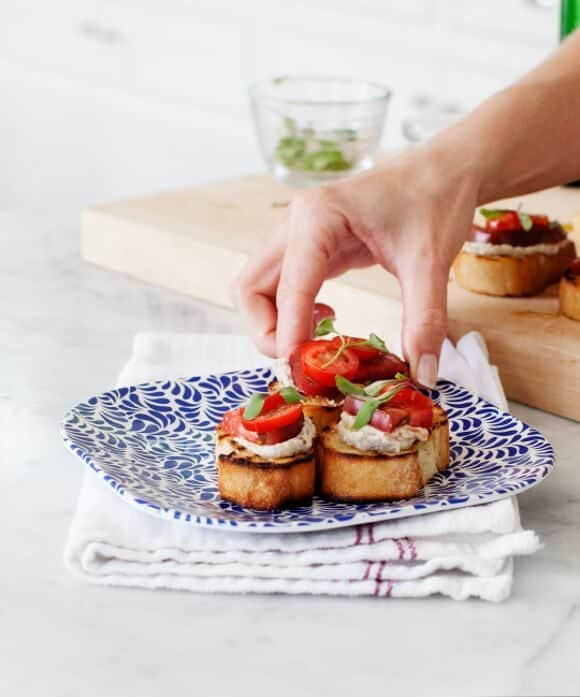 Heirloom tomato sun-cheese toasts (vegan) / @loveandlemons